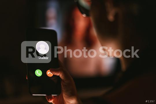 Phone call from a stalker late at night. Stalking or bullying with smartphone concept. Stalker caller, scammer or stranger. Woman answering to incoming call. Ex boyfriend with fake identity.  : Stock Photo or Stock Video Download rcfotostock photos, images and assets rcfotostock   RC-Photo-Stock.: