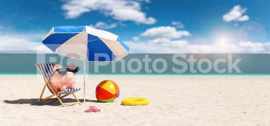 Piggy Bank sunglasses in a beach chair on the Beach with umbrella - Holidays In Economic   : Stock Photo or Stock Video Download rcfotostock photos, images and assets rcfotostock | RC-Photo-Stock.: