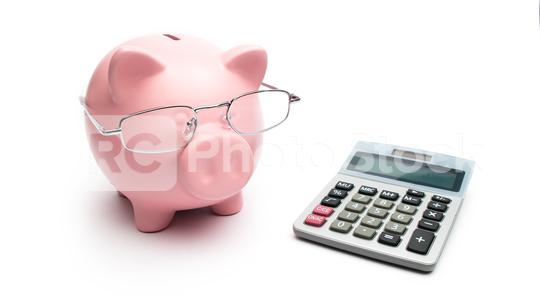 Piggy bank with calculator and Reading glasses on white background  : Stock Photo or Stock Video Download rcfotostock photos, images and assets rcfotostock | RC-Photo-Stock.: