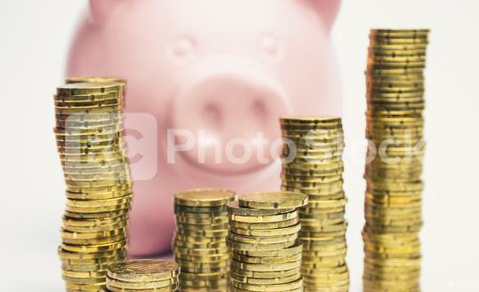 Pink Piggy Bank behind stacked coins - money concept image  : Stock Photo or Stock Video Download rcfotostock photos, images and assets rcfotostock | RC-Photo-Stock.: