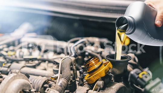 Pouring oil to car engine. Fresh motor oil poured during an oil change to a car.  : Stock Photo or Stock Video Download rcfotostock photos, images and assets rcfotostock | RC-Photo-Stock.:
