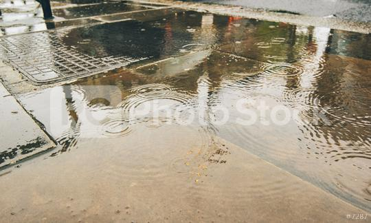 Rain drops rippling in a puddle with reflections in the street  : Stock Photo or Stock Video Download rcfotostock photos, images and assets rcfotostock | RC-Photo-Stock.: