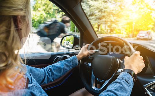 Rear view of attractive young woman in casual wear looking carefully to the road while driving a car.  : Stock Photo or Stock Video Download rcfotostock photos, images and assets rcfotostock | RC-Photo-Stock.: