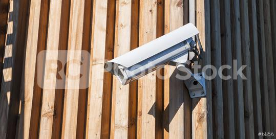 Security camera on a wooden wall  : Stock Photo or Stock Video Download rcfotostock photos, images and assets rcfotostock | RC-Photo-Stock.: