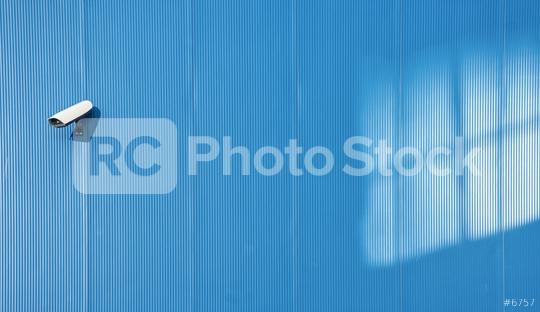 Security camera on the blue wall  : Stock Photo or Stock Video Download rcfotostock photos, images and assets rcfotostock | RC-Photo-Stock.: