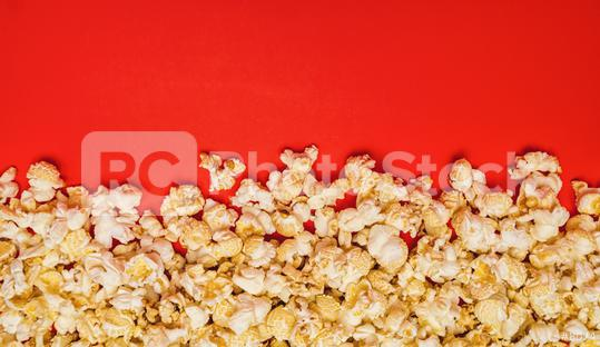 Spilled popcorn on a red background  : Stock Photo or Stock Video Download rcfotostock photos, images and assets rcfotostock | RC-Photo-Stock.: