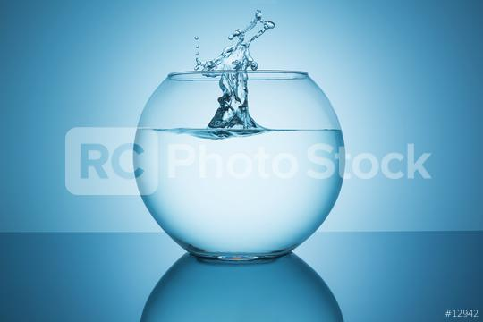 splashing water in a fishbowl  : Stock Photo or Stock Video Download rcfotostock photos, images and assets rcfotostock   RC-Photo-Stock.: