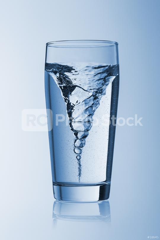 Storm tornado twister typhoon vortex in a water glass drinking on blue background  : Stock Photo or Stock Video Download rcfotostock photos, images and assets rcfotostock   RC-Photo-Stock.: