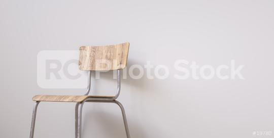 Student chair in front of a grey wall, with copy space for individual text   : Stock Photo or Stock Video Download rcfotostock photos, images and assets rcfotostock | RC-Photo-Stock.: