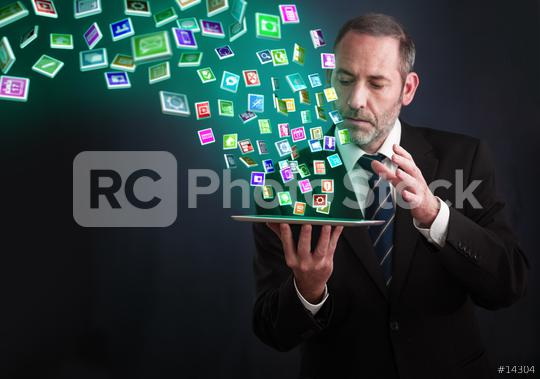 Tablet PC with cloud of application icons  : Stock Photo or Stock Video Download rcfotostock photos, images and assets rcfotostock | RC-Photo-Stock.: