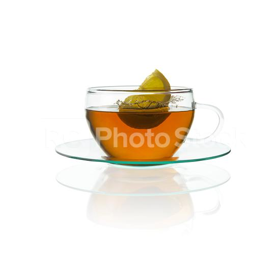 Tea cup glass teapot with a lemon citrus splash hot drink isolated on white background with reflection  : Stock Photo or Stock Video Download rcfotostock photos, images and assets rcfotostock   RC-Photo-Stock.: