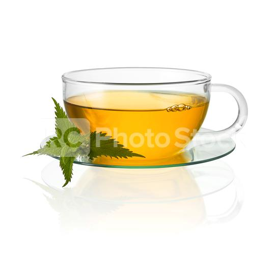 Tea glass with nettle leaf hot drink medicinal plant isolated on white background with reflection  : Stock Photo or Stock Video Download rcfotostock photos, images and assets rcfotostock | RC-Photo-Stock.: