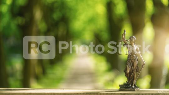 The Statue of Justice - lady justice or Iustitia / Justitia the Roman goddess of Justice on a alley, including copy space  : Stock Photo or Stock Video Download rcfotostock photos, images and assets rcfotostock | RC-Photo-Stock.: