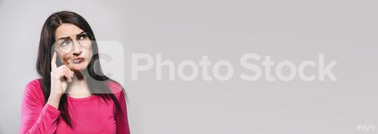 Thoughtful model in studio looking away. hand near the face, banner size, with copyspace for your individual text.  : Stock Photo or Stock Video Download rcfotostock photos, images and assets rcfotostock | RC-Photo-Stock.: