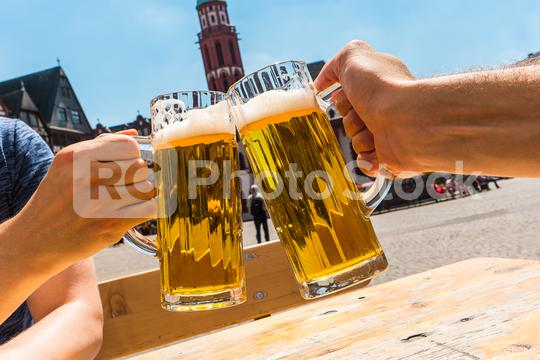 toast with glasses of german beer at the beer garden  : Stock Photo or Stock Video Download rcfotostock photos, images and assets rcfotostock | RC-Photo-Stock.: