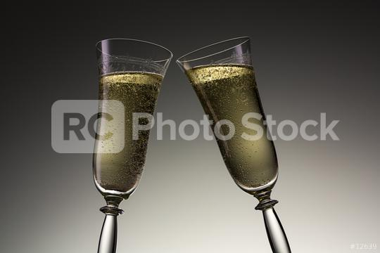 toast with two champagne glasses on new year