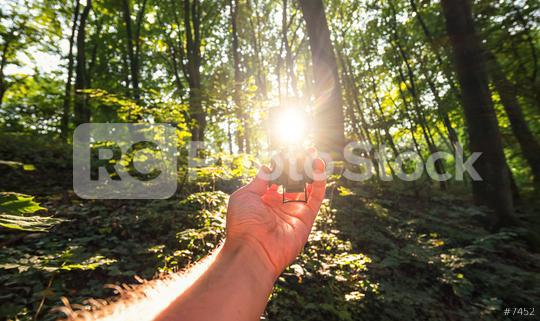 Traveler man searching direction with a compass in the deep woods. Point of view shot with explosive sunlight  : Stock Photo or Stock Video Download rcfotostock photos, images and assets rcfotostock | RC-Photo-Stock.: