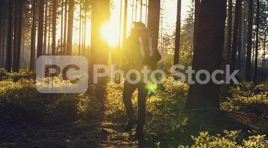 Traveler man walking alonein the woods- Travel Lifestyle emotional concept   : Stock Photo or Stock Video Download rcfotostock photos, images and assets rcfotostock | RC-Photo-Stock.: