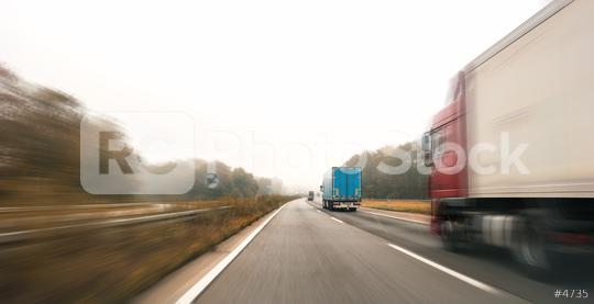 Trucks driving on the highway turning towards the horizon in an autumn landscape with mist, copyspace for your individual text.  : Stock Photo or Stock Video Download rcfotostock photos, images and assets rcfotostock | RC-Photo-Stock.: