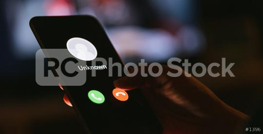 Unknown number calling in the middle of the night. Phone call from stranger. Person holding mobile and smartphone in livingroom late. Unexpected call disturbs at night.  : Stock Photo or Stock Video Download rcfotostock photos, images and assets rcfotostock   RC-Photo-Stock.: