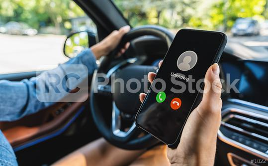 Unknown number calling while car driving. Phone call from stranger. Person holding mobile and smartphone in livingroom late. Unexpected call disturbs at car ride.  : Stock Photo or Stock Video Download rcfotostock photos, images and assets rcfotostock   RC-Photo-Stock.: