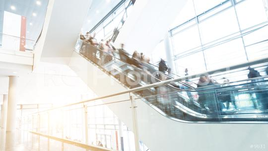 unrecognizable people at escalators on a tradeshow  : Stock Photo or Stock Video Download rcfotostock photos, images and assets rcfotostock | RC-Photo-Stock.: