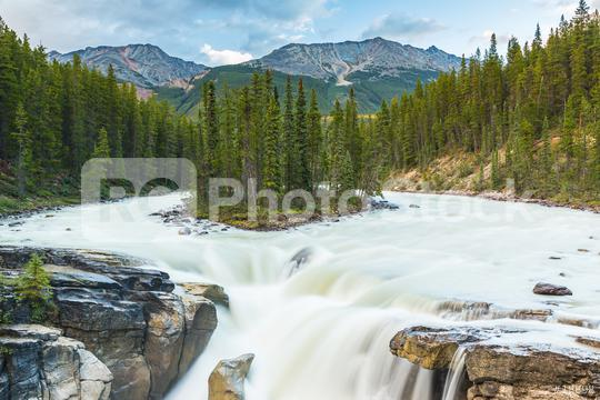 Upper Sunwapta Falls in Jasper National Park, Canada. The water originates from the Athabasca Glacier. Long exposure.  : Stock Photo or Stock Video Download rcfotostock photos, images and assets rcfotostock | RC-Photo-Stock.: