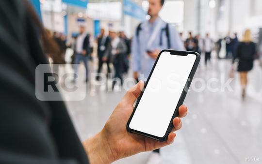view of phone in female hands with empty screen, with crowd of people, copyspace for your individual text.  : Stock Photo or Stock Video Download rcfotostock photos, images and assets rcfotostock | RC-Photo-Stock.: