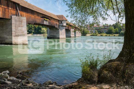 View of the oldest wooden historic border bridge over Rhine river and view to Switzerland in Bad Saeckingen at summer, Black Forest, Baden-Wurttemberg, Germany, Europe  : Stock Photo or Stock Video Download rcfotostock photos, images and assets rcfotostock   RC-Photo-Stock.: