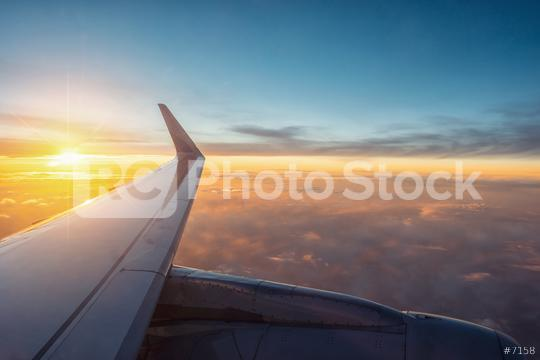 View of the sunset,clouds and airplane wing from the Inside  : Stock Photo or Stock Video Download rcfotostock photos, images and assets rcfotostock   RC-Photo-Stock.:
