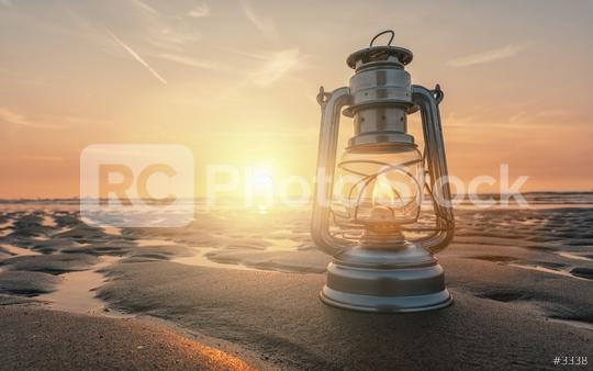 vintage lantern at sunset, romantic evening at the beach  : Stock Photo or Stock Video Download rcfotostock photos, images and assets rcfotostock | RC-Photo-Stock.: