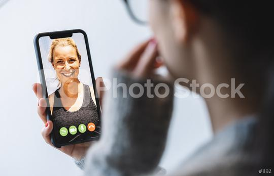 Virtual talking with friends, colleague and using video chat conference. Remote learning or work. Home quarantine or prevention of coronavirus infection (virus covid-19). Woman using smartphone.   : Stock Photo or Stock Video Download rcfotostock photos, images and assets rcfotostock   RC-Photo-Stock.: