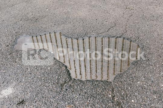 water puddles with raindrops and water circles on cracked wet asphalt road  : Stock Photo or Stock Video Download rcfotostock photos, images and assets rcfotostock   RC-Photo-Stock.: