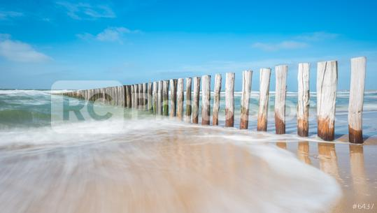 Wave breaker made of wooden stakes on the beach  : Stock Photo or Stock Video Download rcfotostock photos, images and assets rcfotostock | RC-Photo-Stock.: