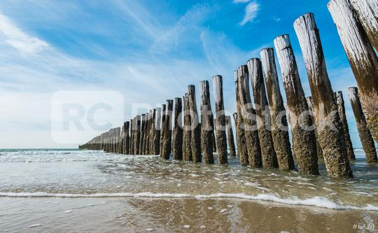 Wave flows around wooden breakwater  : Stock Photo or Stock Video Download rcfotostock photos, images and assets rcfotostock | RC-Photo-Stock.:
