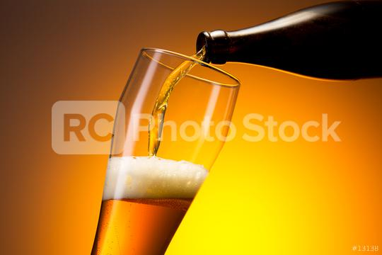 wheat beer pouring out of a bottle  : Stock Photo or Stock Video Download rcfotostock photos, images and assets rcfotostock   RC-Photo-Stock.: