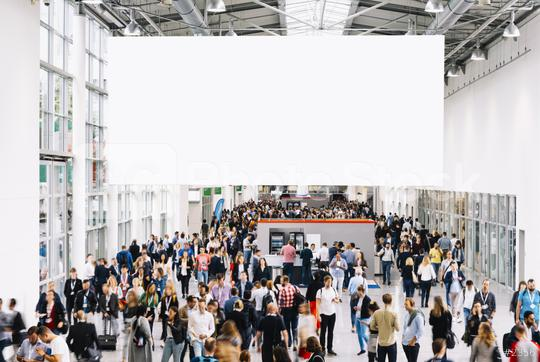 White illuminated advertising as a mock-up in the trade fair about many people  : Stock Photo or Stock Video Download rcfotostock photos, images and assets rcfotostock | RC-Photo-Stock.: