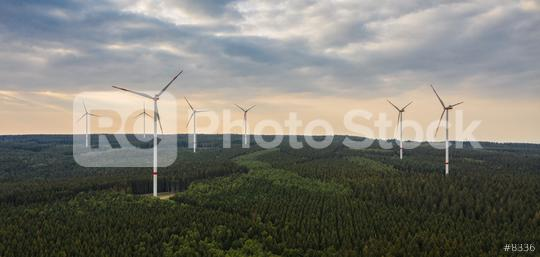 wind farm in the forest at sunset - energy production with clean and renewable energy - aerial shot  : Stock Photo or Stock Video Download rcfotostock photos, images and assets rcfotostock   RC-Photo-Stock.: