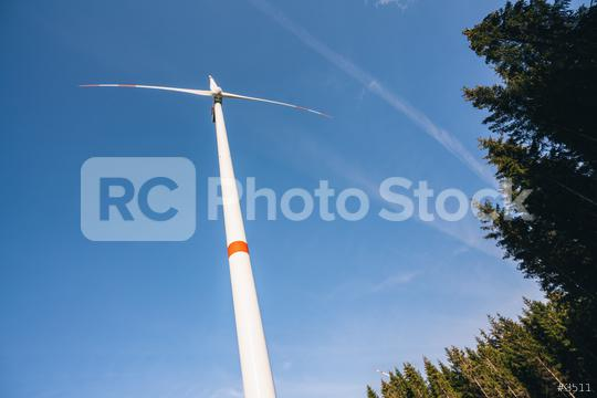 Wind turbine in the forest generating electricity with blue sky - energy conservation concept  : Stock Photo or Stock Video Download rcfotostock photos, images and assets rcfotostock | RC-Photo-Stock.: