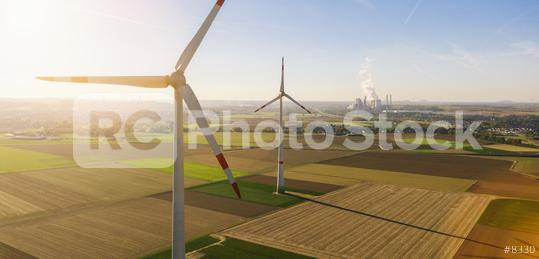 Wind turbine with coal power plant view from drone - Sustainable development, environment friendly, renewable energy concept - copyspace for your individual text  : Stock Photo or Stock Video Download rcfotostock photos, images and assets rcfotostock   RC-Photo-Stock.:
