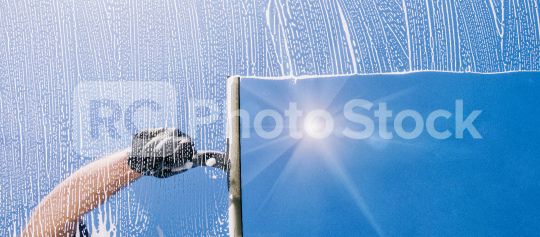 Window cleaner cleans window with foam and puller, banner size  : Stock Photo or Stock Video Download rcfotostock photos, images and assets rcfotostock | RC-Photo-Stock.: