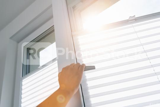 woman hand opens a pvc window with roller  : Stock Photo or Stock Video Download rcfotostock photos, images and assets rcfotostock | RC-Photo-Stock.: