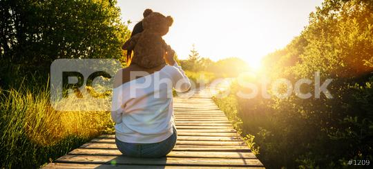 Woman holding teddy bear toy on his shoulders at sunset, copyspace for your individual text.  : Stock Photo or Stock Video Download rcfotostock photos, images and assets rcfotostock | RC-Photo-Stock.:
