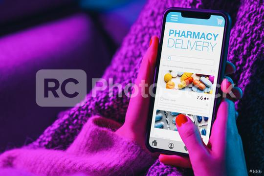 Woman lies on sofa holding mobile phone with internet pharmacy shopping app. Pharmacy shop Mokup. Medical, help, support online. Health care telemedicine application on smartphone screen application.  : Stock Photo or Stock Video Download rcfotostock photos, images and assets rcfotostock   RC-Photo-Stock.: