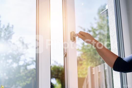 woman opens a window with a mosquito net  : Stock Photo or Stock Video Download rcfotostock photos, images and assets rcfotostock | RC-Photo-Stock.:
