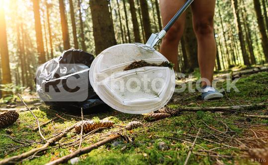 woman picking up garbage plastic with a picker for cleaning the forest, nature and environment cleaning concept image.  : Stock Photo or Stock Video Download rcfotostock photos, images and assets rcfotostock   RC-Photo-Stock.: