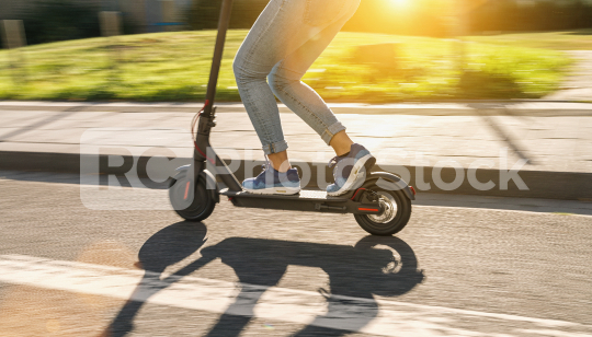 woman riding black electric kick scooter at cityscape at summer, motion blur  : Stock Photo or Stock Video Download rcfotostock photos, images and assets rcfotostock   RC-Photo-Stock.: