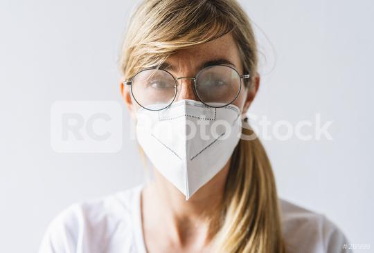 Woman wearing N95 FFP2 an anti virus protection mask and glasses are fogged up to prevent others from corona COVID-19 and SARS cov 2 infection  : Stock Photo or Stock Video Download rcfotostock photos, images and assets rcfotostock   RC-Photo-Stock.:
