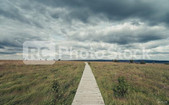 Wooden boardwalk through the recreation area high Venn (Hautes fagnes) in belgium with dramtic cloudy sky.  : Stock Photo or Stock Video Download rcfotostock photos, images and assets rcfotostock | RC-Photo-Stock.: