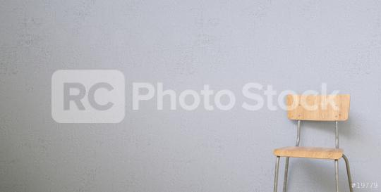 wooden chair in front of a grey wall, with copy space for individual text   : Stock Photo or Stock Video Download rcfotostock photos, images and assets rcfotostock | RC-Photo-Stock.: